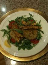 Pip Taylor's corn cakes on rocket leaves with tomatoes and leftover turkey spiced up with a little curry.